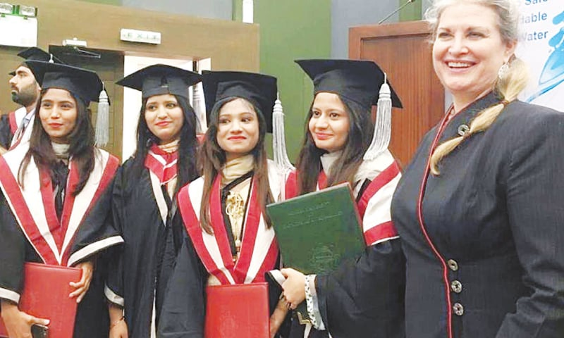 US Consul General JoAnne Wagner is all smiles as she poses for a group photo with fresh graduates at MUET on Friday.—PPI
