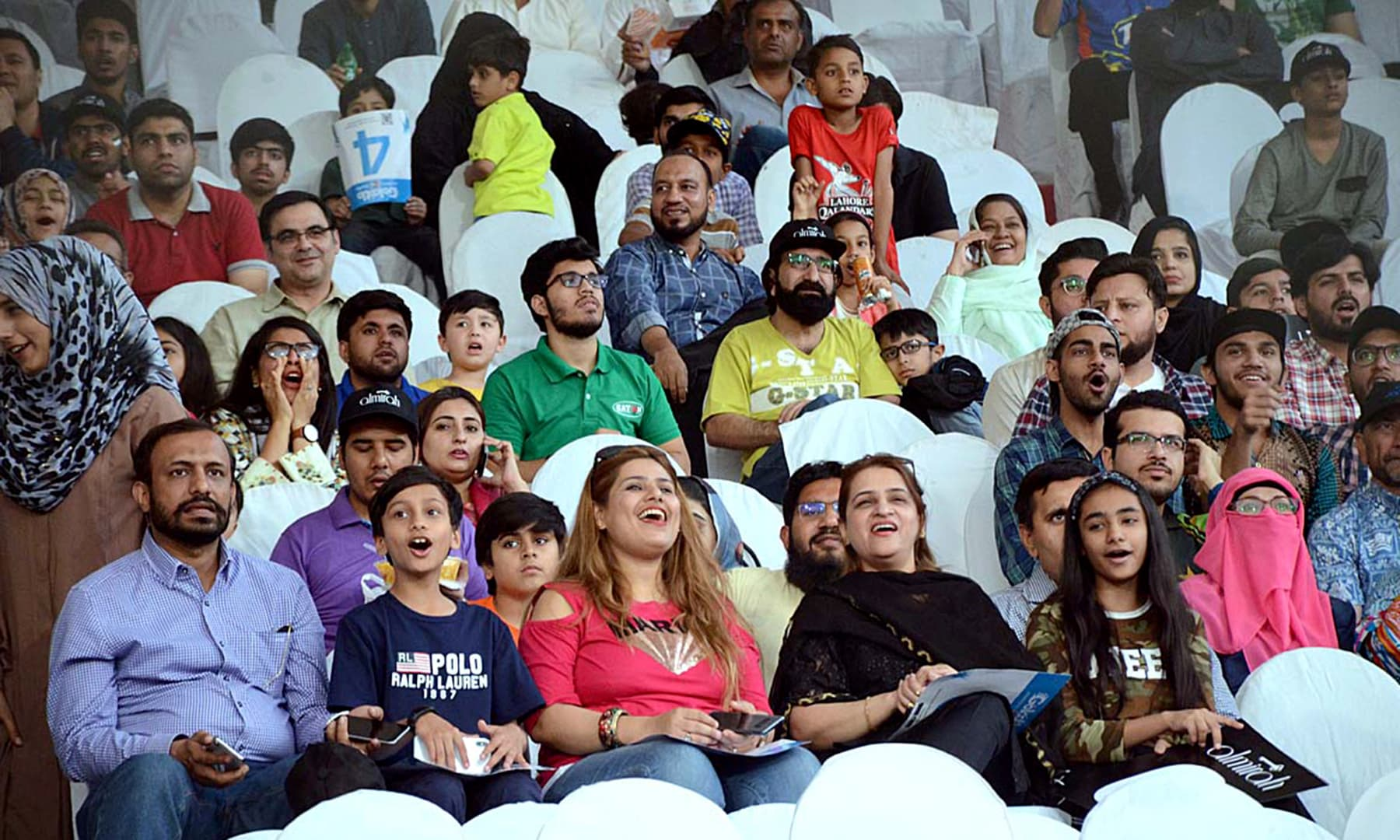 Spectators viewing the intense face-off between Islamabad United and Lahore Qalandars. — APP