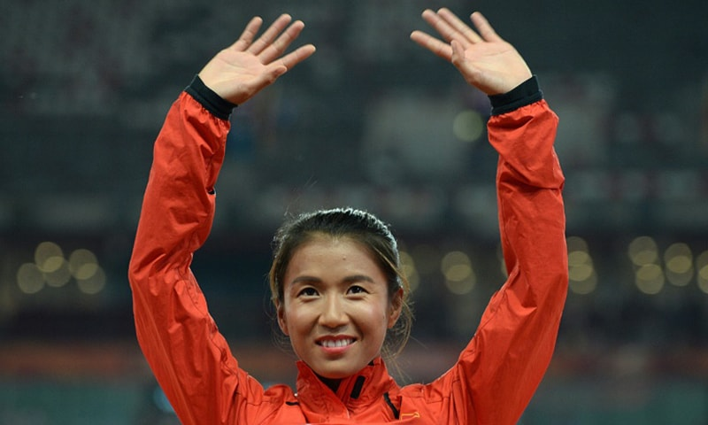 China's Liu Hong becames the first woman to dip under the four-hour mark.— AFP