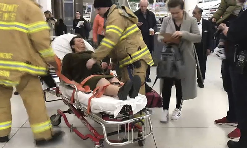In this still image taken from video provided by WNBC-TV News 4 New York, emergency medical personnel tend to an injured passenger from a Turkish Airlines flight at New York's John F. Kennedy International Airport on Saturday. — AP