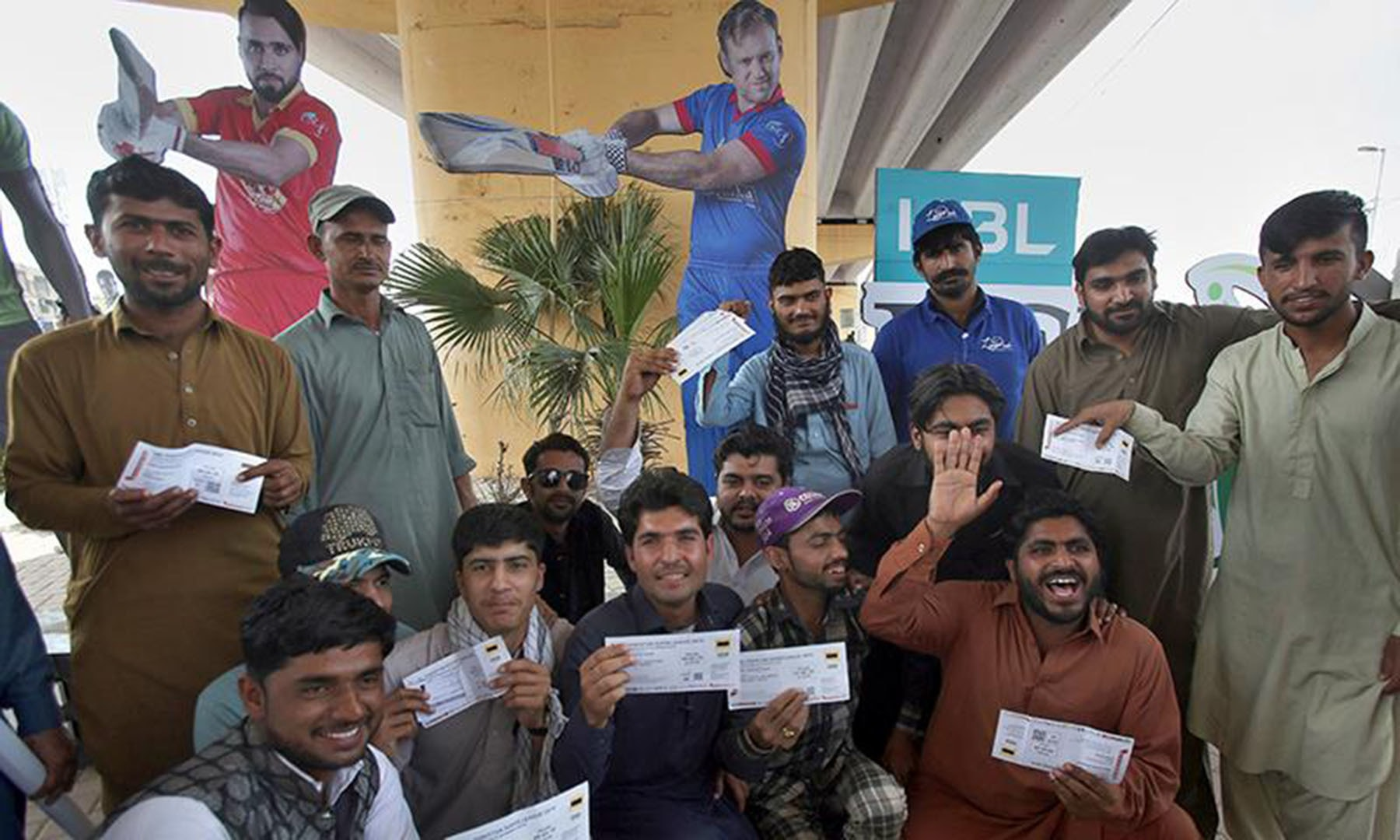 Fans show their tickets upon arrival at National Stadium ahead of the PSL match on Saturday. — AP