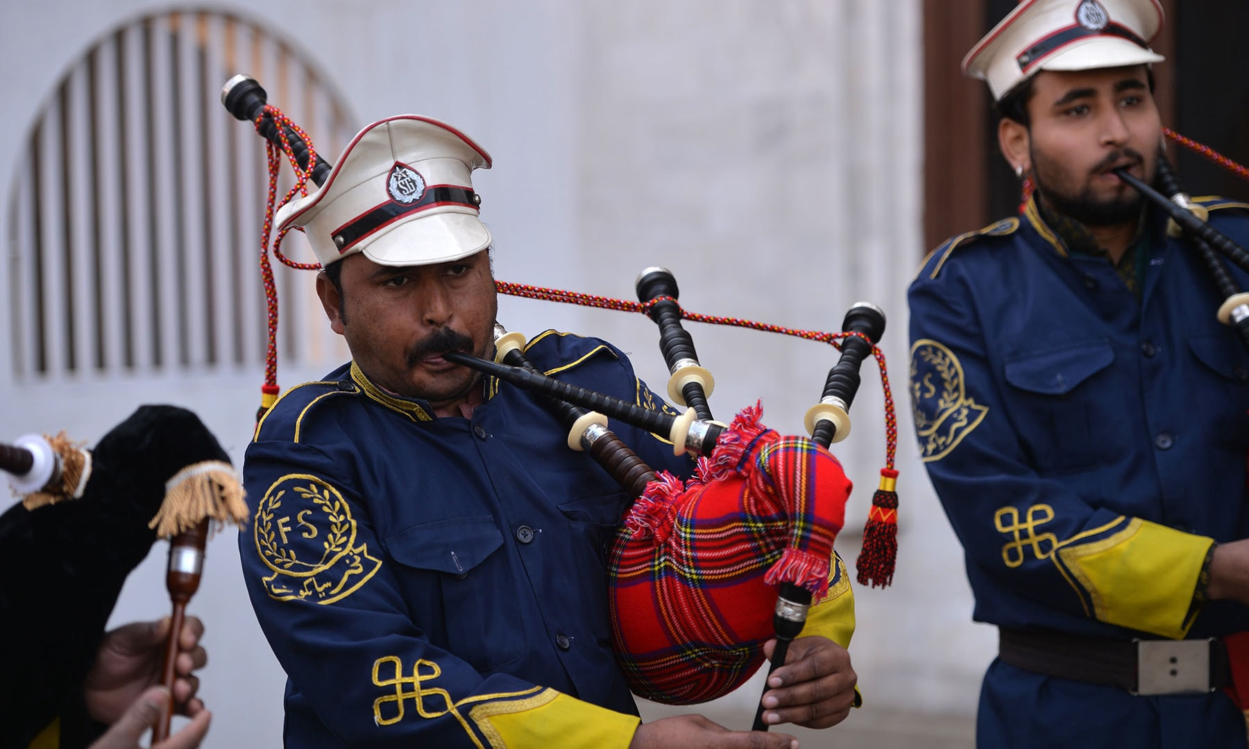 In this picture taken on January 25, a Pakistani musical band perform with bagpipes made at the Mid East bagpipe factory in  Sialkot.  — AFP
