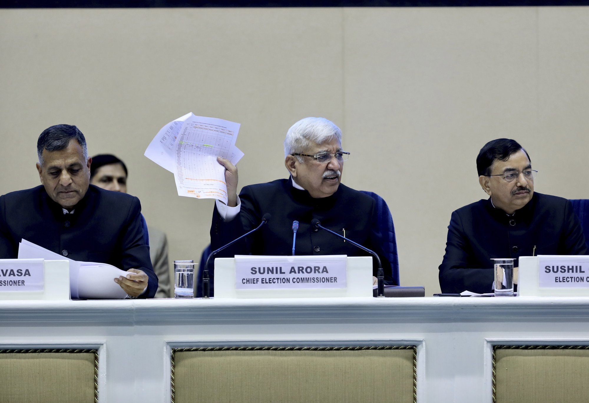 India's Chief Election Commissioner Sunil Arora, center, speaks during a press conference in New Delhi on Sunday. ─ AP