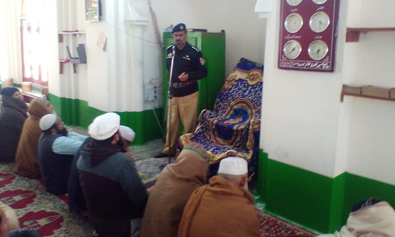 A sub-inspector speaks to a congregation at a mosque in Lower Kohistan, moving them to wage jihad against 'honour' killings and crime. — Photo by author