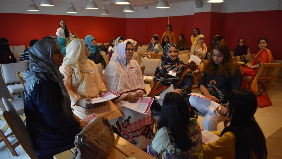 Ambreen (centre) attends the teacher training workshop organised by Dot & Line