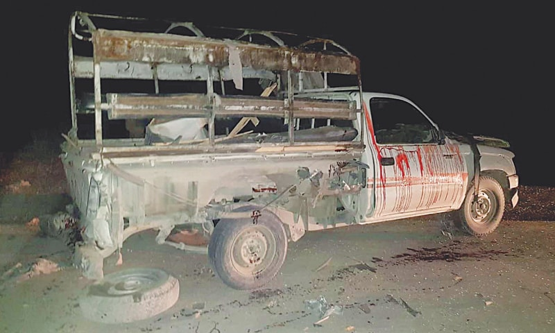 QUETTA: A view of the damaged police van that came under attack. (Right) The wreckage of motorcycle that was rigged with an improvised explosive device.—INP