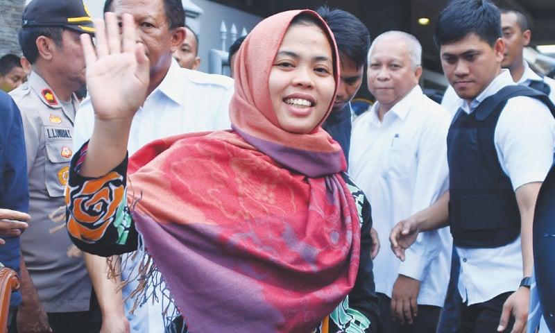 Jakarta: Siti Aisyah waves after a press conference on Monday.—AFP