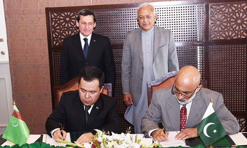 The agreement was signed by Additional Secretary In-charge of the Petroleum Division Mian Asad Hayauddin and Muhammetmyrat Amanov, chief executive of TAPI Pipeline company. — Photo courtesy Radio Pakistan
