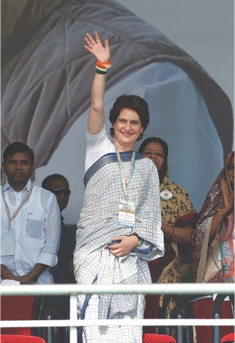 Ahmedabad: Congress leader Priyanka Gandhi Vadra waves to her supporters during a rally at Adalaj, 30 kilometres from Ahmedabad.—AFP