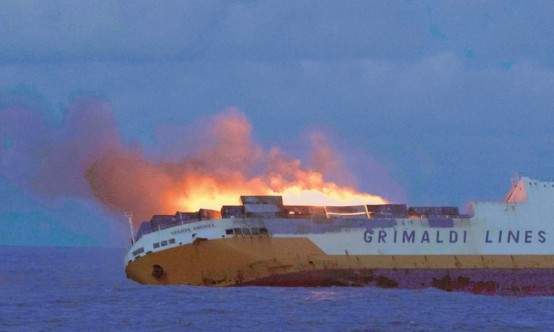 This handout picture released on Tuesday by the French maritime agency shows flames on an Italian merchant ship off the coast of Brittany. All 27 people aboard the ship were saved by a British naval vessel after its containers and cars caught fire. The stricken ship's crew were unable to fight the flames and were planning to abandon it.—AFP