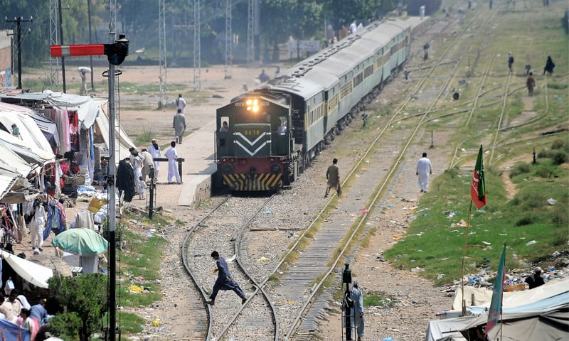 A train approaches a populated area in Peshawar. The ML1 project is a key element of  CPEC and seeks to upgrade the entire track from Peshawar to Karachi to allow speeds up to 120km per hour.