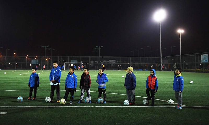 This file picture taken on December 14, 2016 shows boys taking part in a training session at a football club in Beijing. — AFP