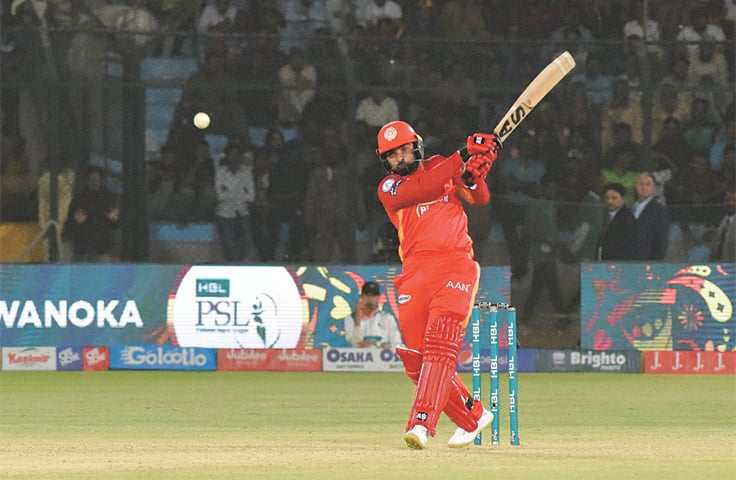 KARACHI: Asif Ali of Islamabad United hits a boundary during a match against Karachi Kings at the National Stadium on Thursday.—Tahir Jamal / White Star