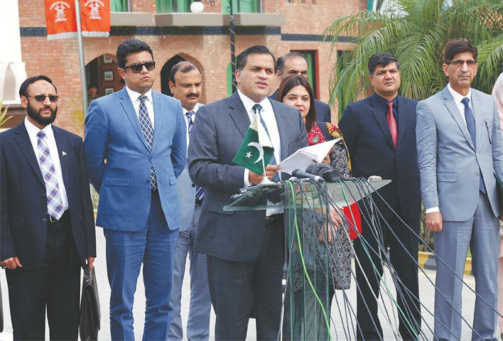 FOREIGN Ministry spokesman Dr Mohammad Faisal talking to journalists at the Wagah border crossing on Thursday.—AP