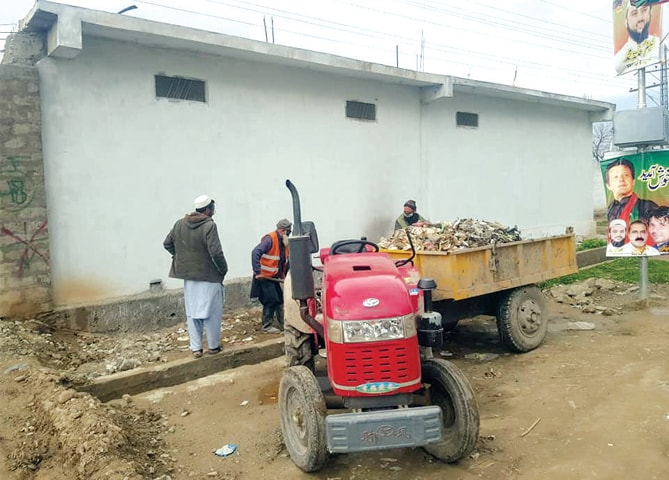 Cleanliness drive underway in Bajaur ahead of the prime minister's visit to the region. — Dawn