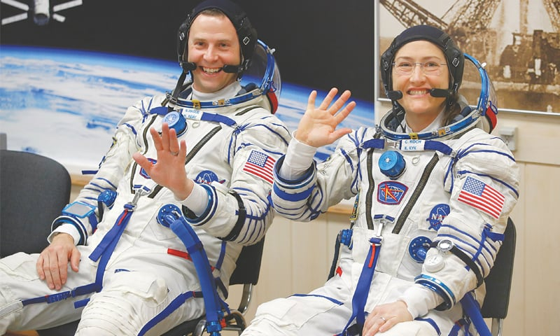 BAIKONUR (Kazakhstan): US astronauts Christina Hammock Koch (right) and Nick Hague wave before the launch of Soyuz MS-12 space ship at Baikonur cosmodrome on Thursday.—AP