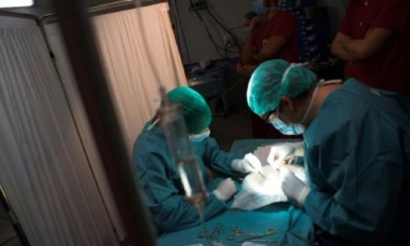 Two surgeons, making arrangements for a surgery, are seen in this file photo. —AFP/File