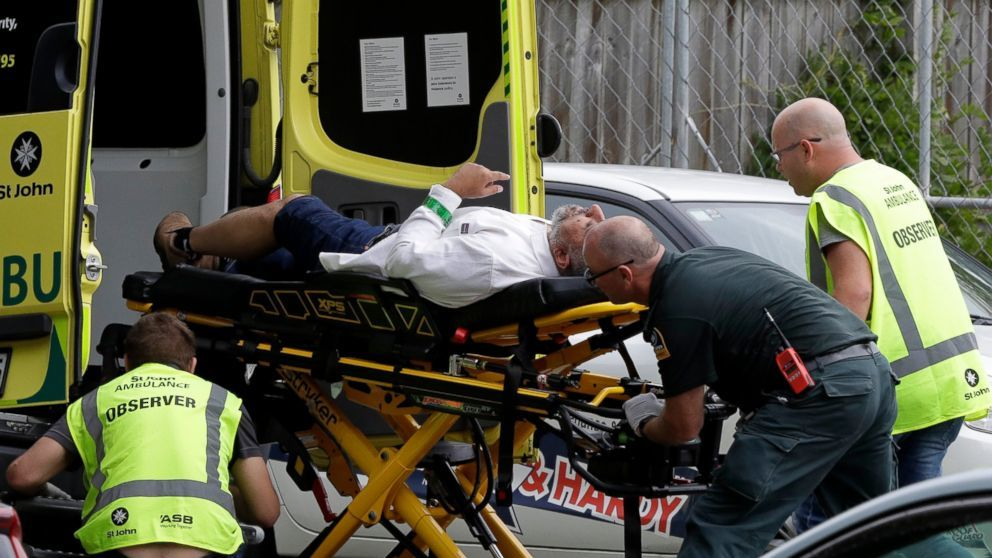 Ambulance staff take a man from outside a mosque in central Christchurch, New Zealand on Friday. — AP