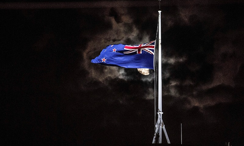 The New Zealand national flag is flown at half-mast on a Parliament building in Wellington on March 15, 2019, after the shooting incident in Christchurch. — AFP