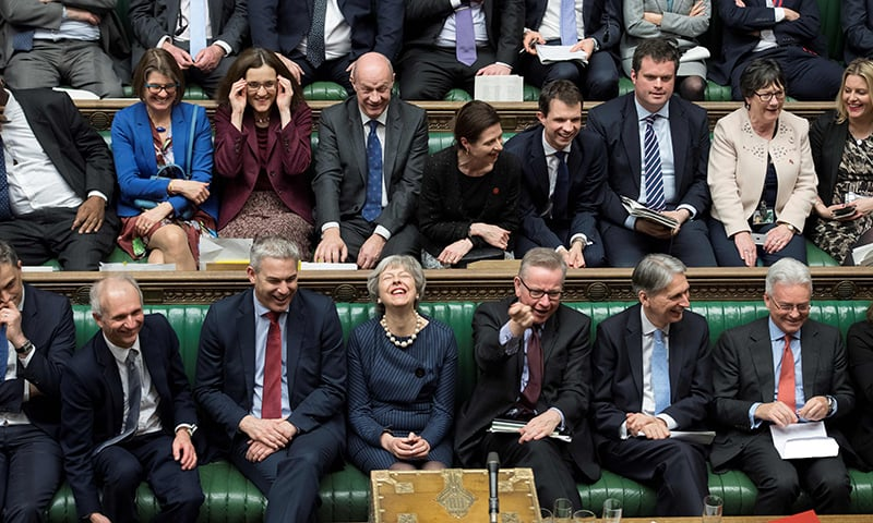 A handout photograph released by the UK Parliament on March 14 shows Britain's Prime Minister Theresa May (C) reacting on the front bench in the House of Commons in London during the proceedings in which British MPs voted to ask the European Union to delay Brexit. — AFP