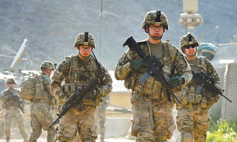 US soldiers march from a forward base in the eastern province of Kunar in this file picture.—AFP