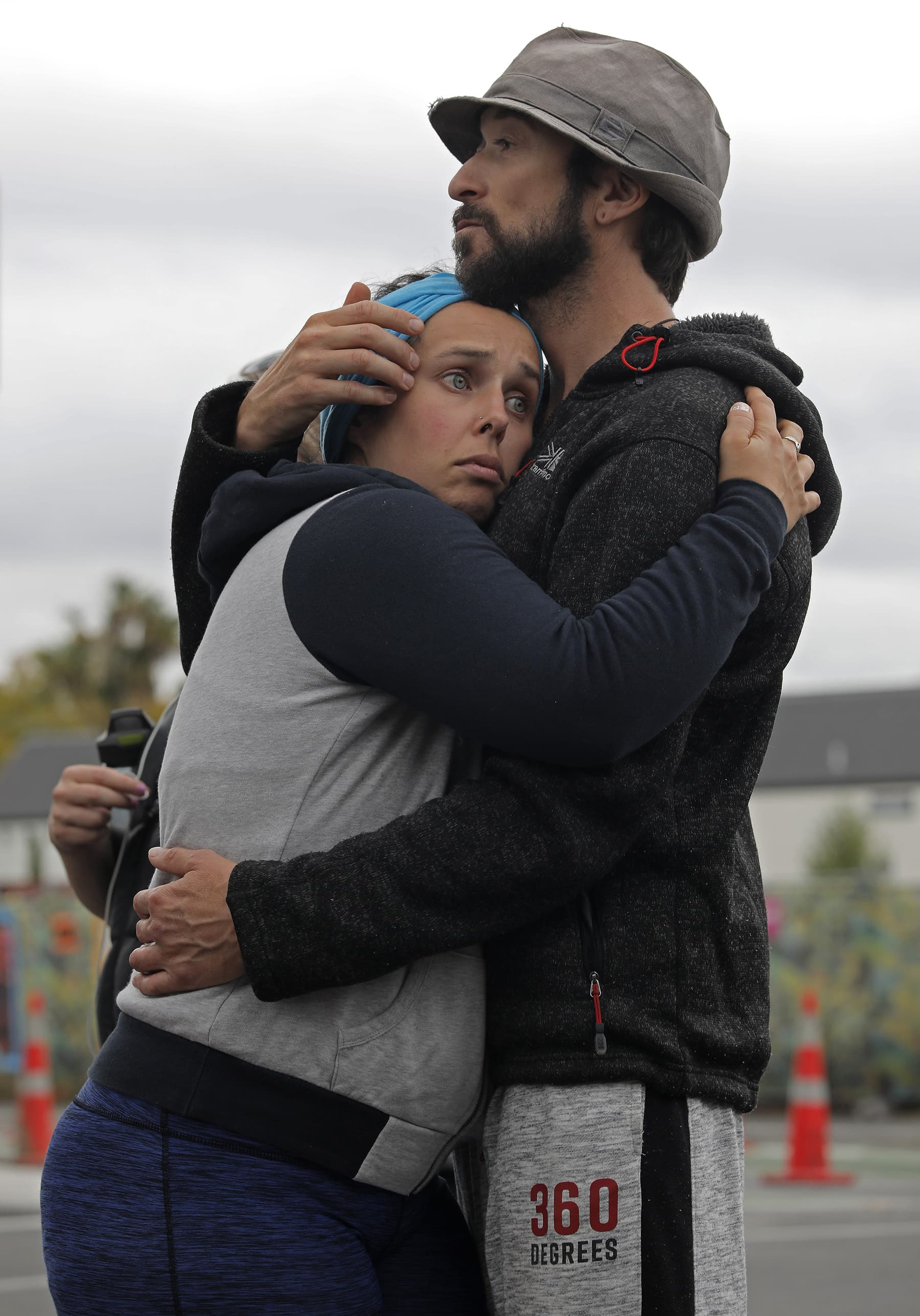 Mourners hug as they pay their respects at a makeshift memorial near the Masjid Al Noor mosque in Christchurch, New Zealand, Saturday, March 16, 2019. —AP