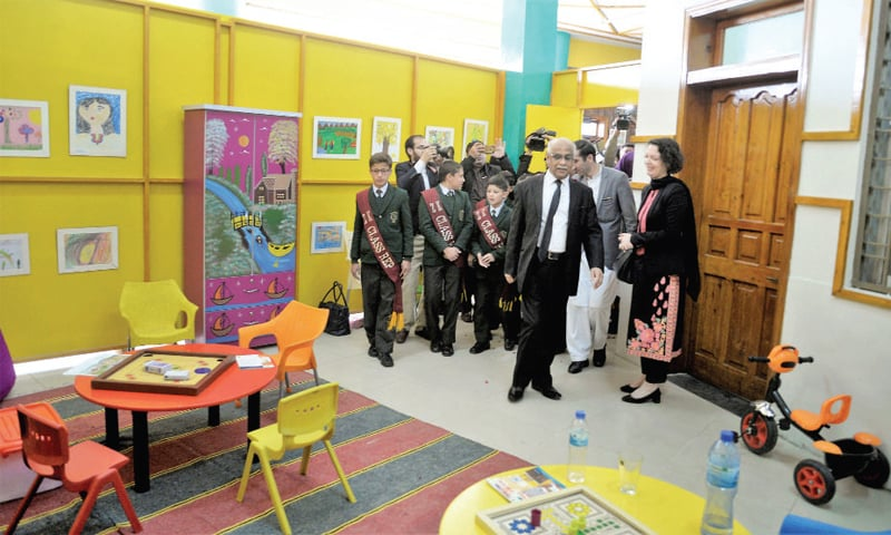 Peshawar High Court Chief Justice Waqar Ahmad Seth inspects a room for children  after inaugurating the first child protection court at the judicial complex in Peshawar on Saturday. — White Star