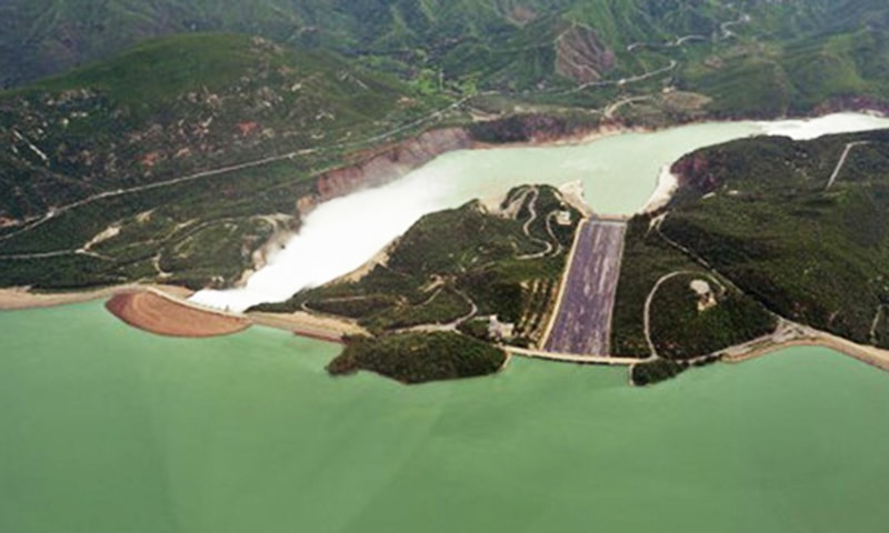 This aerial view shows water leaving the Tarbela Dam spillway in Tarbela.—AFP/File