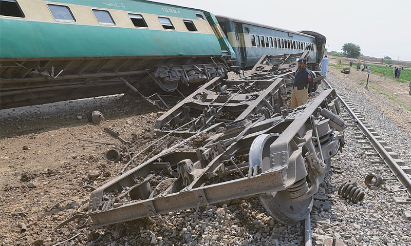 NASIRABAD: A policeman examines damaged carriages of Jaffar Express after the bomb blast.—AP