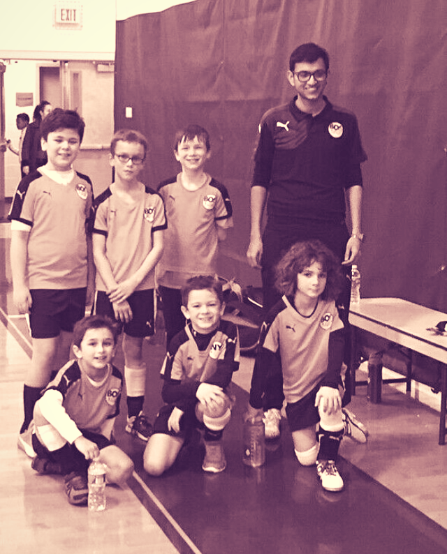 Emad as a coach with his players.