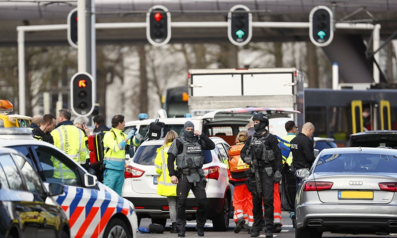 Emergency services stand at the 24 Oktoberplace in Utrecht, on March 18, 2019 where a shooting took place. — AFP