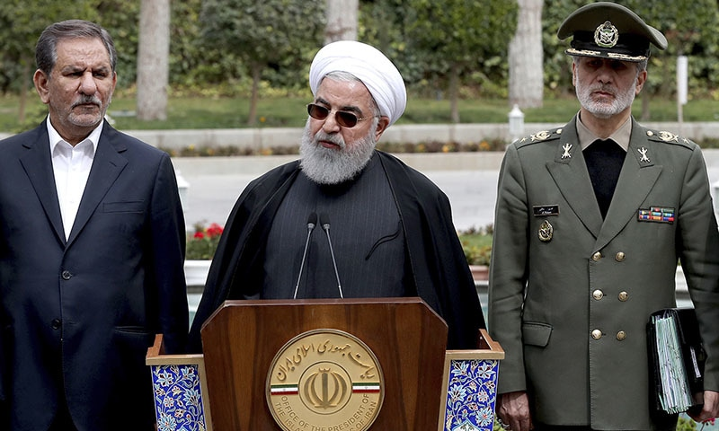 In this photo released by an official website of the office of the Iranian Presidency, President Hassan Rouhani speaks during a media briefing after a cabinet meeting, as senior Vice President Eshaq Jahangiri, left, and Defense Minister Gen Amir Hatami listen, in Tehran on Monday. — AP