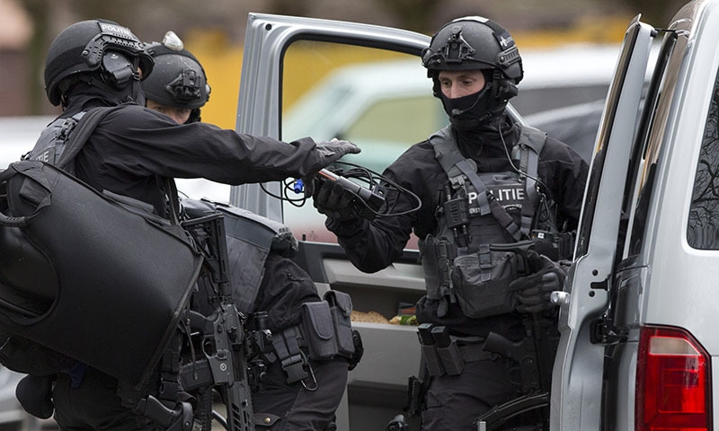 Dutch counterterrorism police prepare to enter a house after a shooting incident in Utrecht, Netherlands on Monday. — AP