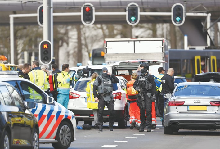 EMERGENCY services personnel stand at the 24 Oktoberplace in Utrecht, where the shooting took place.—AFP