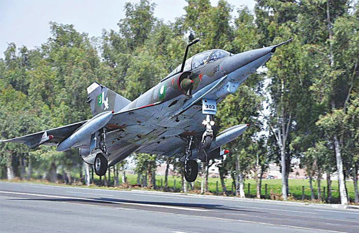 A PAKISTAN Air Force Mirage aircraft landing on one of the country's motorways during road runway operations on Monday. In a bid to remain prepared for any emergency, the PAF fighter aircraft carried out off-runway operations along motorways and highways.—APP