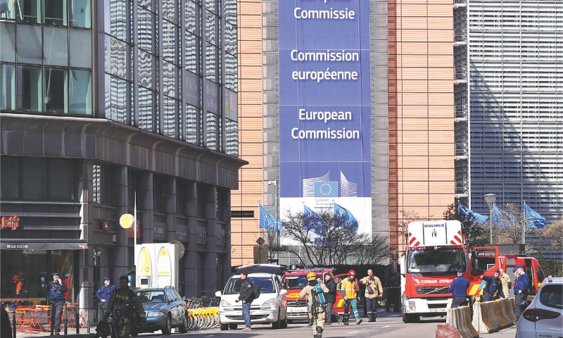 Brussels: Police and firefighters secure an area after the bomb alarm in a building near the European Commission's headquarters.—Reuters