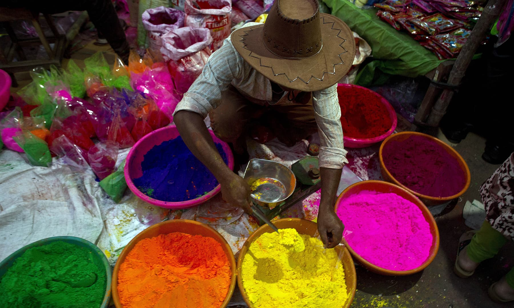 An Indian street vendor sells colored powder a day ahead of Holi, the festival of colors, in Gauhati, India, Wednesday, March 20, 2019. — AP