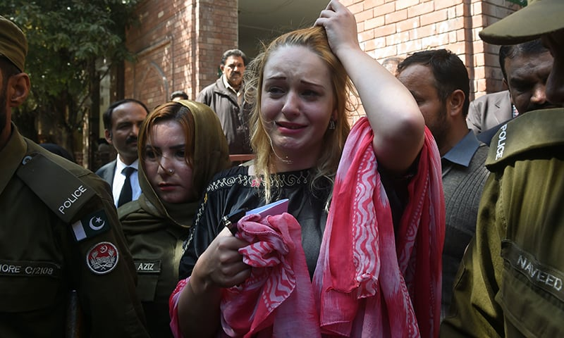 Czech model Tereza Hluskova weeps after the court decision to sentence her to eight years and eight months in prison for attempted heroin smuggling, in Lahore on March 20, 2019. —AFP