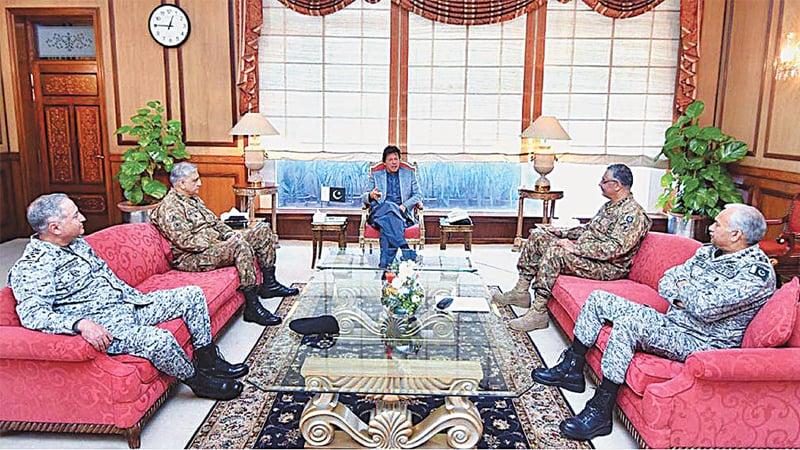ISLAMABAD: Prime Minister Imran Khan speaks to the Joint Chiefs of Staff Committee chairman and services chiefs during a meeting at PM Office on Wednesday.—APP