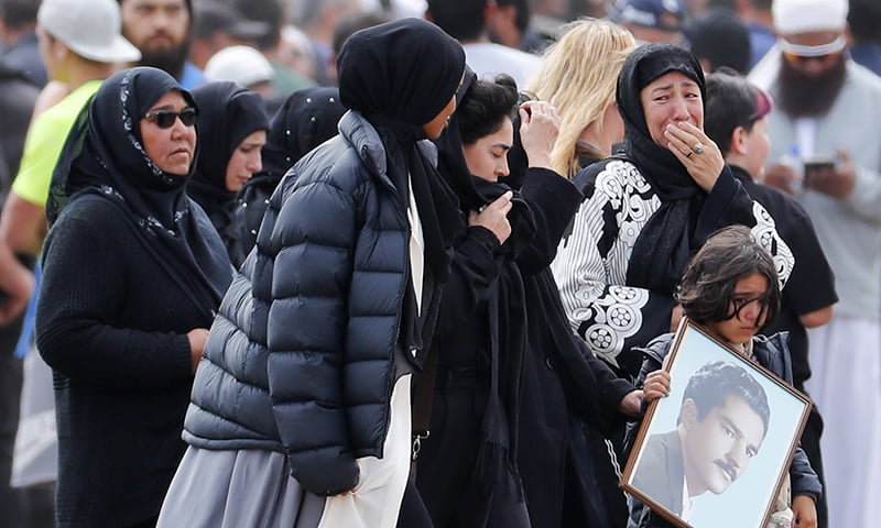 Mourners react before a burial service of a victim from the March 15 mosque shootings at the Memorial Park Cemetery in Christchurch, New Zealand, Thursday, March 21, 2019. — AP