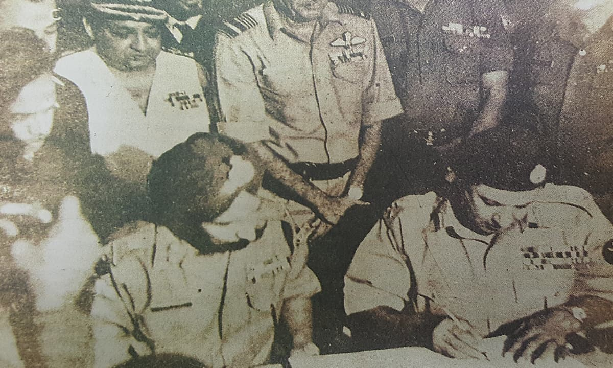 Bitter legacy: General Niazi signs the document of surrender to General Arora | Photo from The *Herald*, April 1997