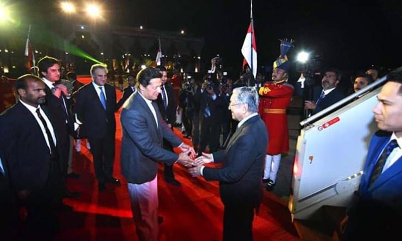 PM Khan receives Malaysian premier Dr Mahathir at Nur Khan airbase