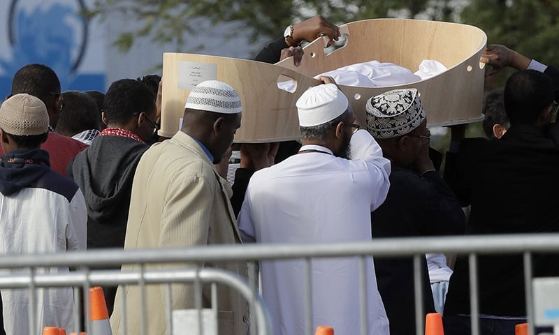 Mourners carry the casket of the youngest victim 3-year-old Mucaad Ibrahim at the Memorial Park Cemetery in Christchurch. — AP