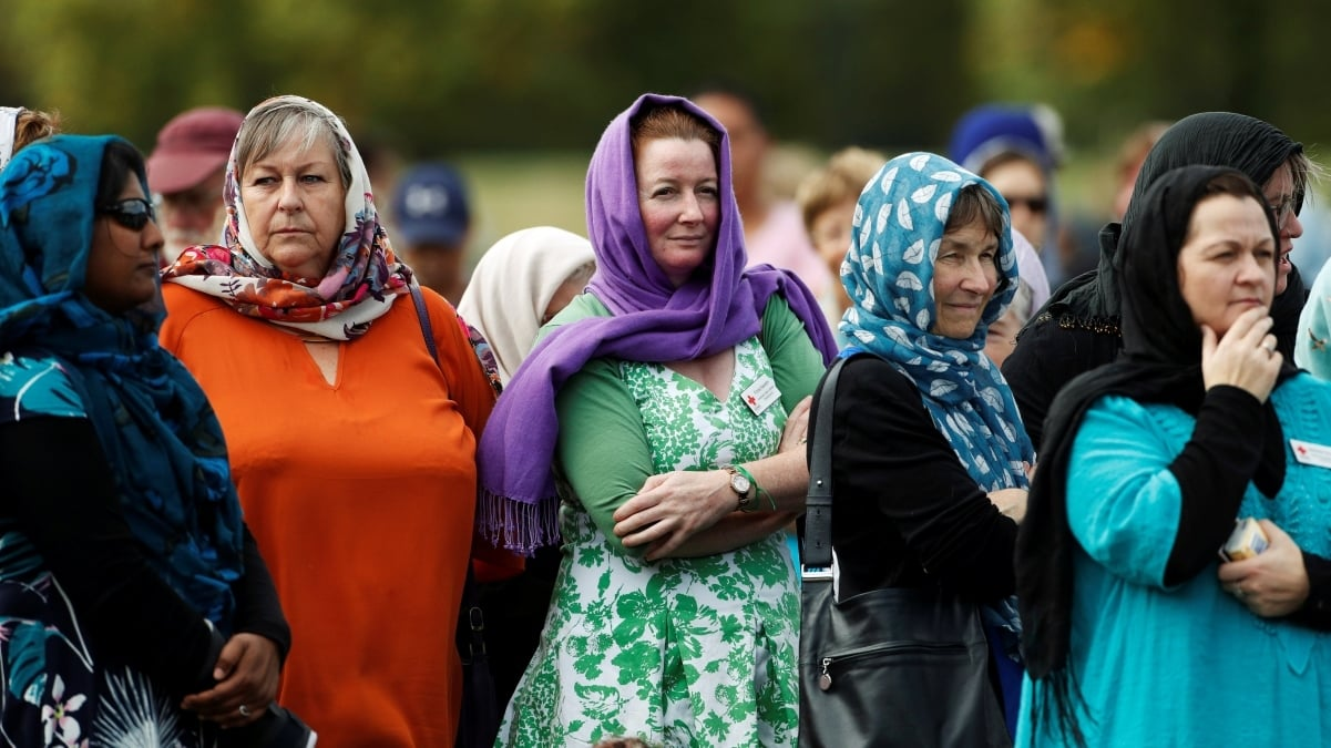 Women wearing headscarves as tribute to the victims of the mosque attacks are seen before Friday prayers at Hagley Park outside Al-Noor mosque in Christchurch, New Zealand March 22, 2019. —Reuters/Jorge Silva