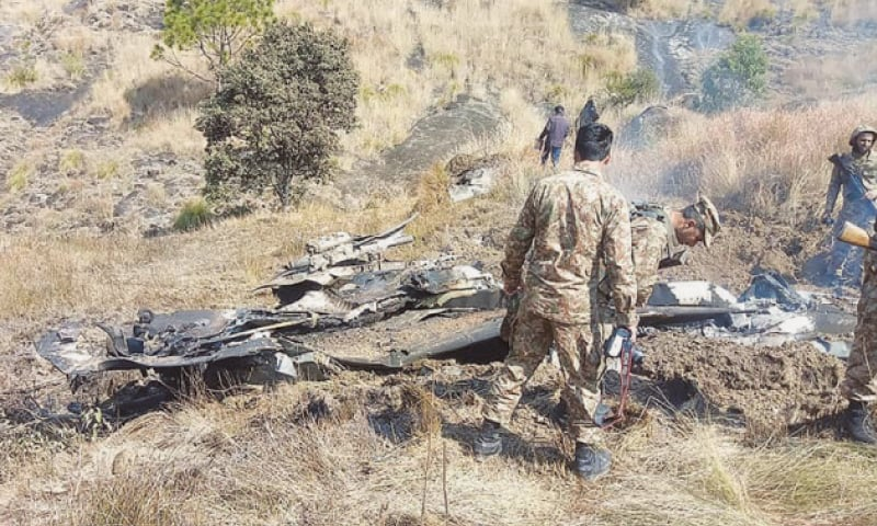 The soldiers of Pakistan Army rummaging through the wreckage of the Indian jet after it intruded into the Pakistani airspace.