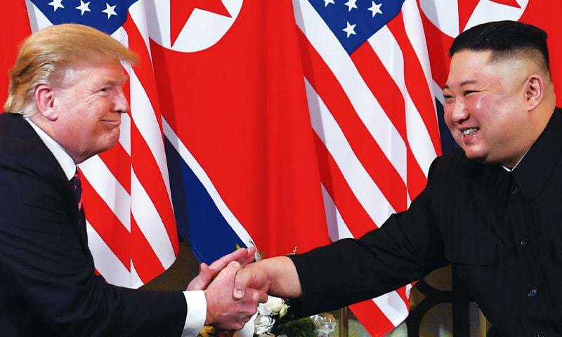 US President Donald Trump and North Korean leader Kim Jong Un are all smiles as they shake hands during their February summit.— AFP/File