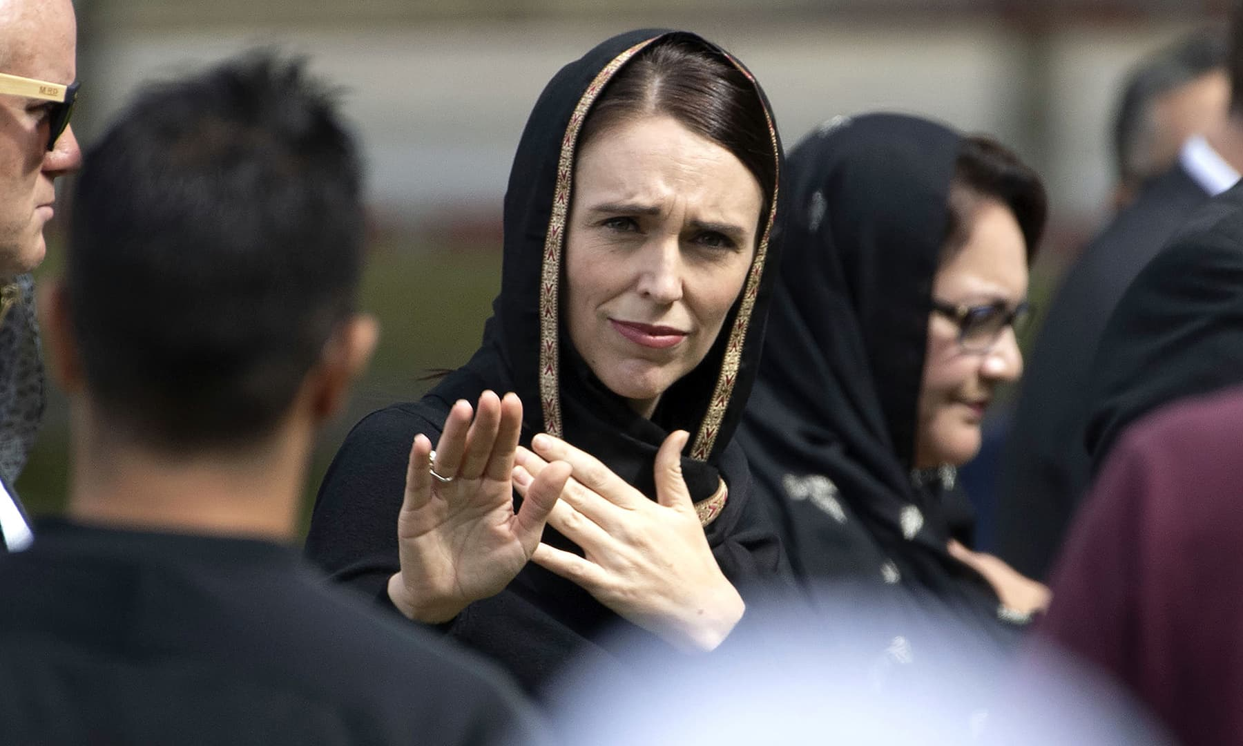 New Zealand's Prime Minister Jacinda Ardern gestures as she departs following a gathering for congregational Friday prayers and two minutes of silence for victims of the twin mosque massacre, at Hagley Park in Christchurch. — AFP