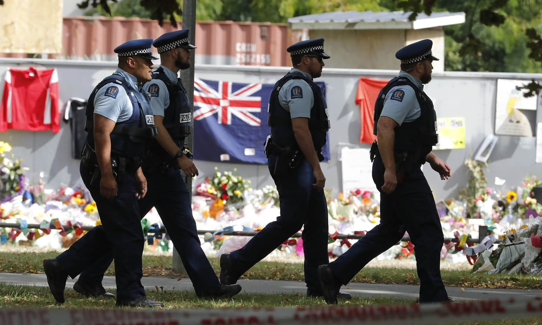 Armed police officers patrol outside Al Noor mosque ahead of Friday prayers at Hagley Park in Christchurch. — AP