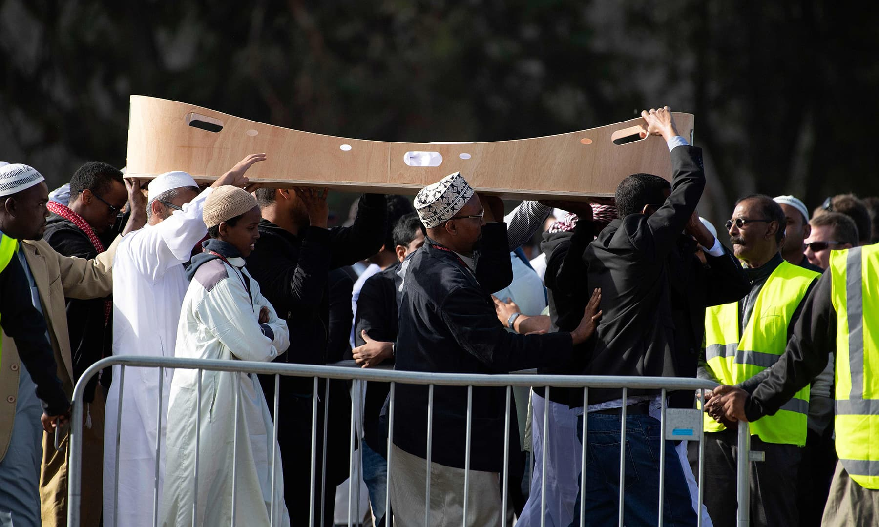 Mourners carry the casket of a victim who was killed in the New Zealand twin mosque massacre at Memorial Park Cemetery during a burial in Christchurch. — AFP