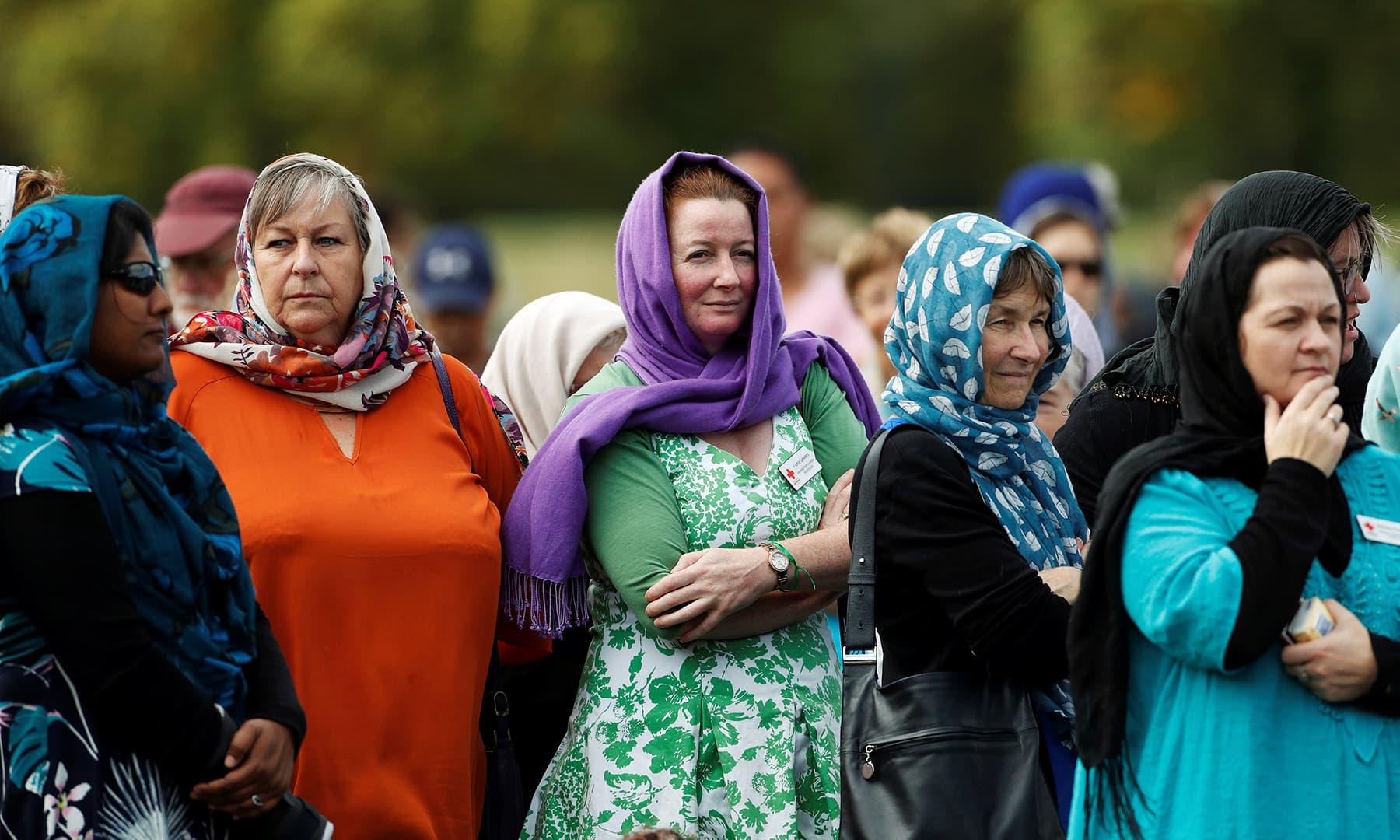 Women wearing headscarves as tribute to the victims of the mosque attacks are seen before Friday prayers at Hagley Park outside Al Noor mosque in Christchurch. — Reuters